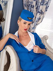 Evey is ready to take off in fully fashioned nylons high heels and classic white lingerie.