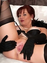Sophisticated, redhead Holly in dark-hued lingerie, panties and ff nylons!