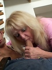 The wrinkled blonde grandma gets his young dick hard and he tags her labia deeply