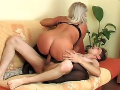 Big-boobed mature gal woken up with a stiff fresh dick into her mouth and cunt