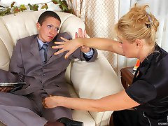 Lewd babe in male suit taking out strap-on to drill ripe twat of mature gal