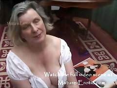 Granny Tess in mini mini-skirt showing off her plump pussy