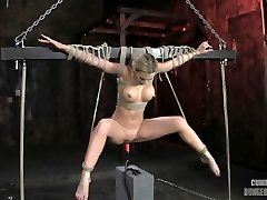 athena angel suspended over pounding machine