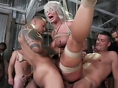 Busty Milf stripper strapped and gangbanged