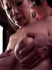 Japanese AV Model rubs cocks of her big boobs PublicSexJapan.com