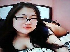 Cute chubby asian teen on webcam