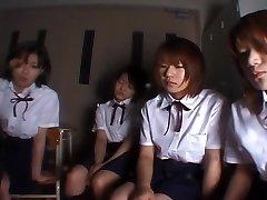 Four Japanese college girls spitting on schoolteacher