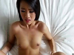 Asian drilled in the bed