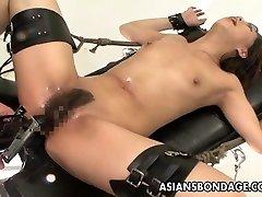 Bound Asian treats sex machines like a trooper