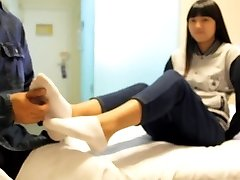chinese kittle girl with sock and bare