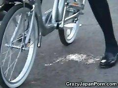 College Girl Sprays on a Bike in Public!