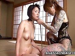 Inked up Asian domina strap on boning the sub