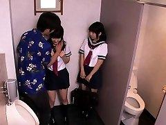 Japanese schoolgirls three way fuck with dude in restroom
