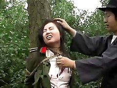 Chinese army girl corded to tree 1