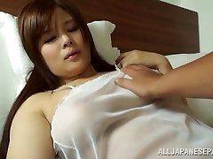 Japanese AV Model is a steaming cougar in transparent lingerie