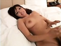 Stunning Asian lady with marvelous ginormous boobs gives a sensua