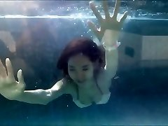 Young Asian Girl in Luxurious Bathing Suit at a Swimming Pool