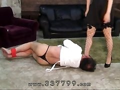 Japanese femdom gimps penis in molten wax.