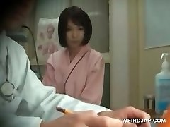 Redhead asian hotty gets boobs checked at doctor