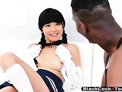 Asian cutie gets her sweet muff railed by huge black boner