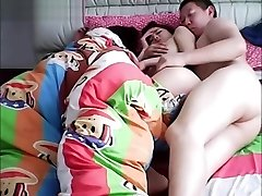 Chinese spouse cheating on wife while she is sleeping.
