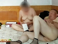 chinese granddad giving it all to grandmother