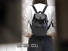 Asian women caught in public toilets