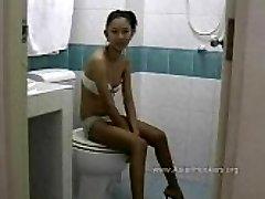 Thai Hooker Sucks Man Rod in the Toilet