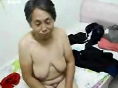 Asian Grandma get dressed after fuckfest