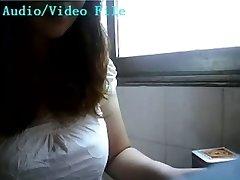 Asian female lactating on webcam
