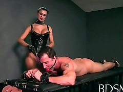 Sexy Mistress loves teasing her gimp boys stiff cock while he's handcuffed