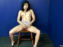 Fantastic Asian babe petting on her wet puss