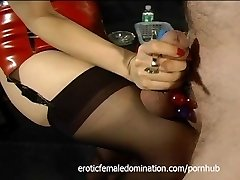 Tied-up and ball-gagged stud has his cock pleasured by an Japanese bimbo