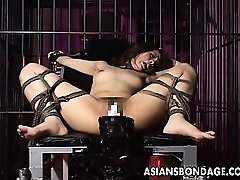 Fabulous girl is tied up and plowed by big machine