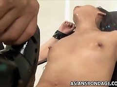 Chinese babe bond and fuckd by a humping machine
