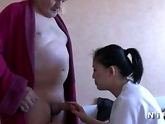 Youthfull nurse blows an aged man