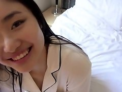 Japanese teenie plays with hard-on in the morning