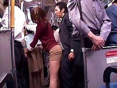 Chinese tramp sucks dick in a public bus