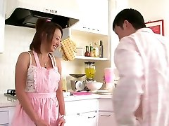 Lovely Chinese babe loves to suck cock in the kitchen