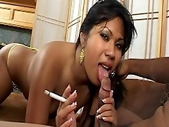 Asian honey with cute mounds smokes ciggy and gets cum facial on couch