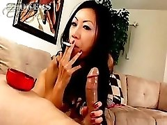 Tia Ling likes to suck on a cigarette and a hard jizz-shotgun at once