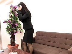 Woman in suit and stocking masturbates when she is alone