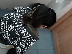 an Chinese chick in a jumper urinating in public toilet for absolute ages