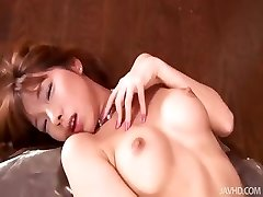 Insane Serina in candlelight toys her wooly pussy over and over again