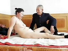 Handsome Chinese grandpa giving poking