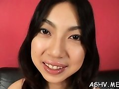 Beautiful oriental honey plays with toys on shaved vag