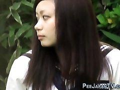 Asian teenie rubs and pees