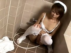 Nasty nurse Mio Hiragi in the douche masturbating
