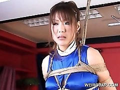 Roped asian prego sex slave gets huge mammories rubbed