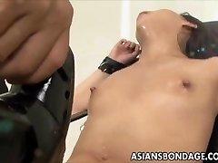 Chinese babe bond and fuckd by a fucking machine